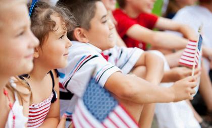 Young Girl Waves American Flag